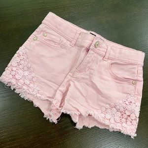Girls shorts with lace details.